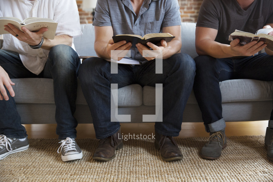 men's group Bible study discussing scripture