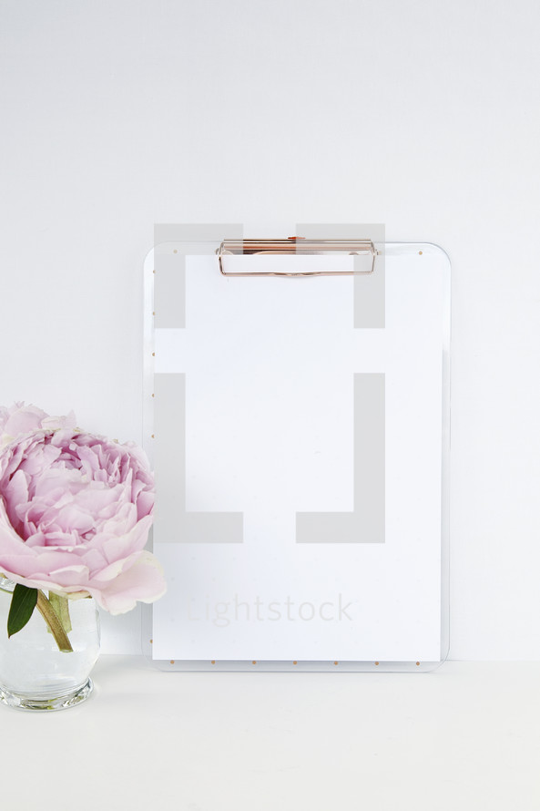 pink peony and clipboard