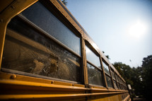 broken window on a school bus
