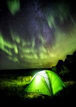 Aurora over a tent.