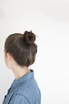 woman with hair in a bun