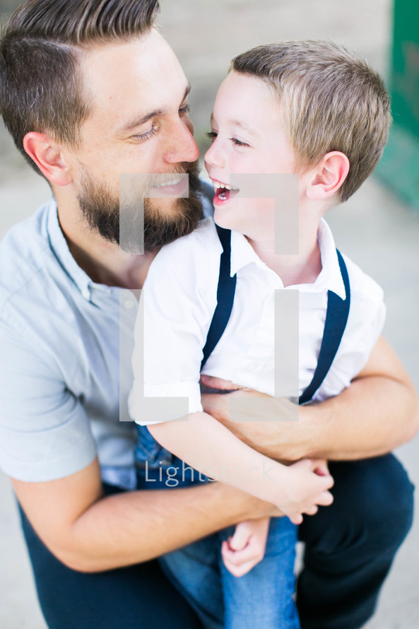 a father hugging his son