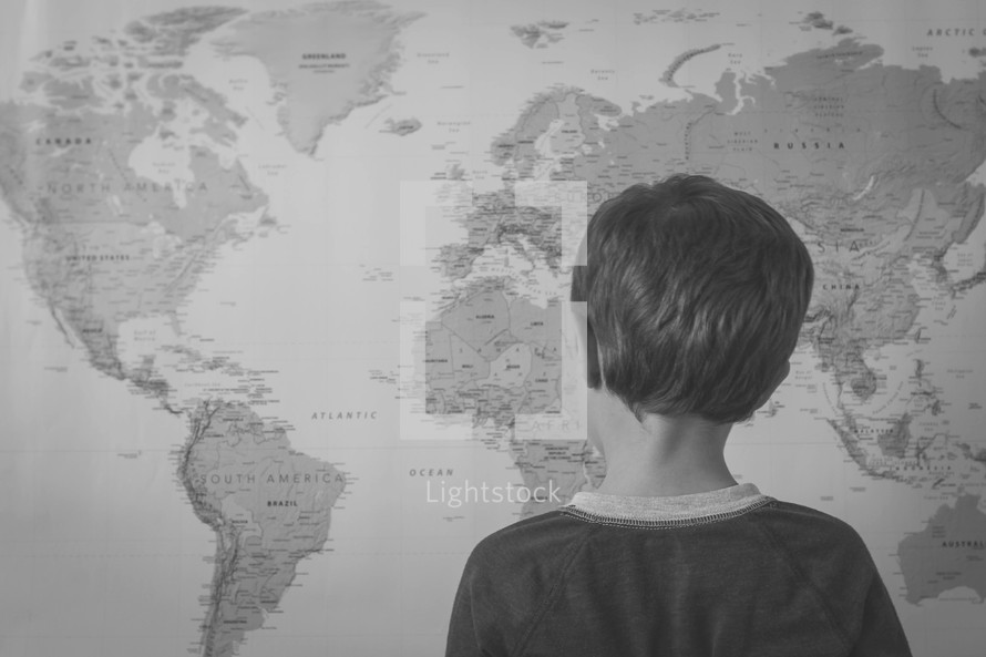 world map and child looking at it