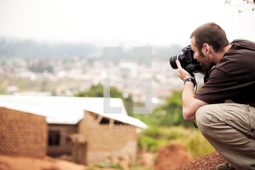 Photographer taking photo outdoors