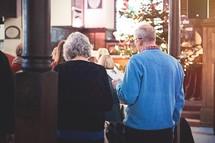 congregation singing Christmas hymns at church