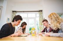 teens reading Bibles at a Bible study