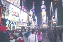 crowd gathered in Times Square NYC at night