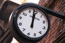 Clock showing two minutes before midnight 11:58