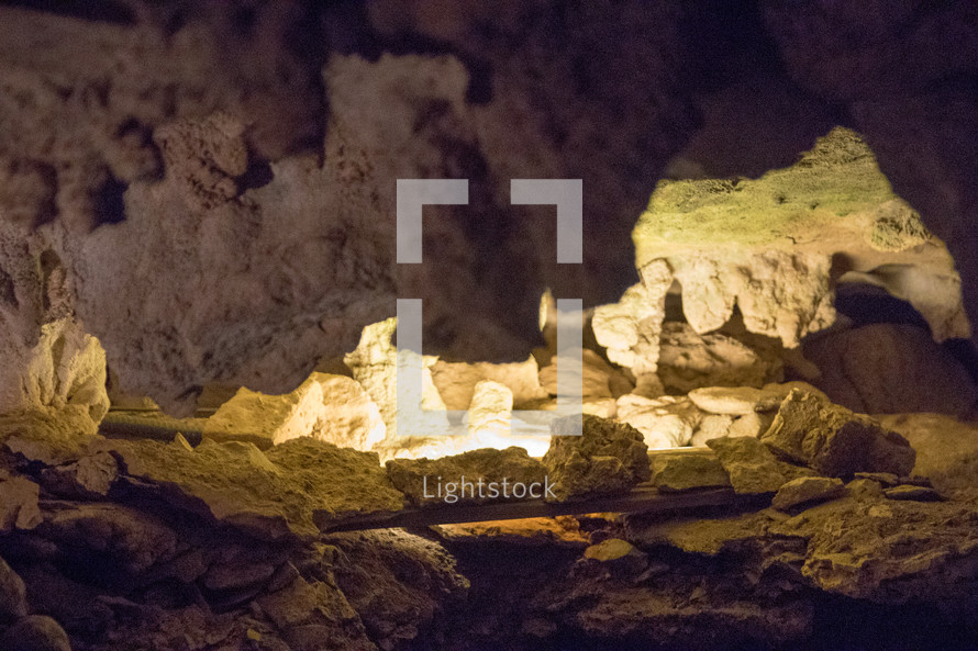 sunlight shining into rocks in a cave