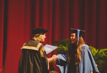 woman receiving her diploma at graduation