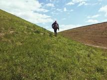 man running up a hill