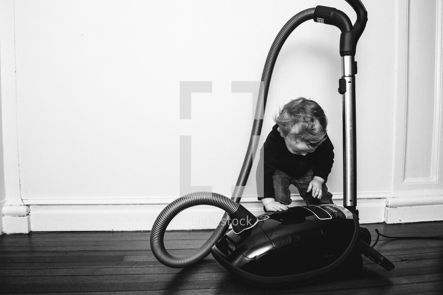 toddler boy and a vacuum
