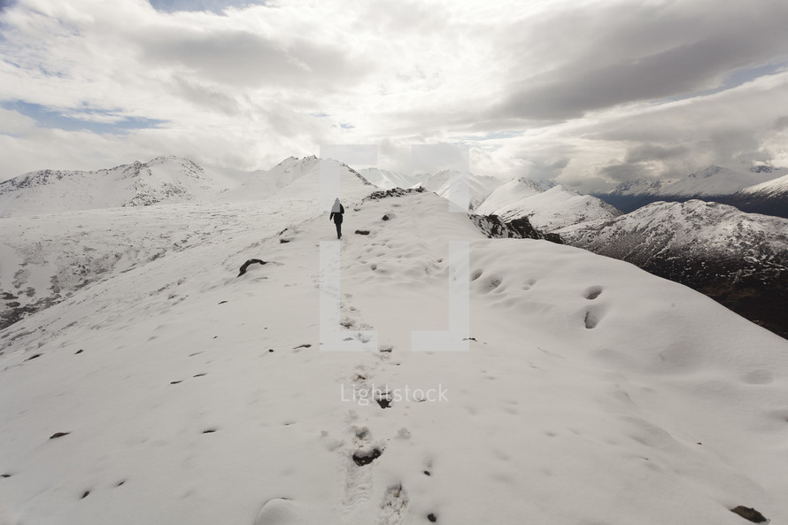 hiking up a snow covered mountain