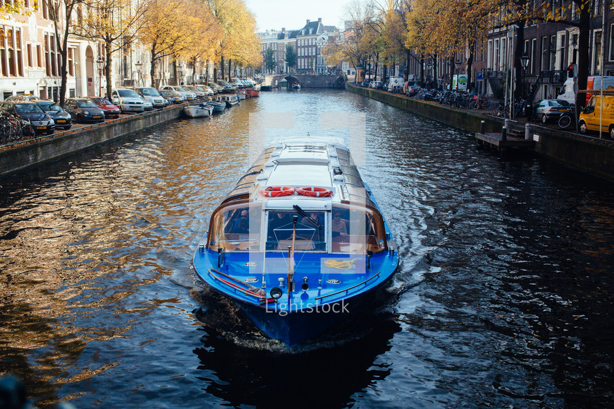 a water taxi on a channel in Amsterdam