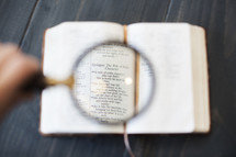 Magnifying glass on Proverbs 31 in the Bible