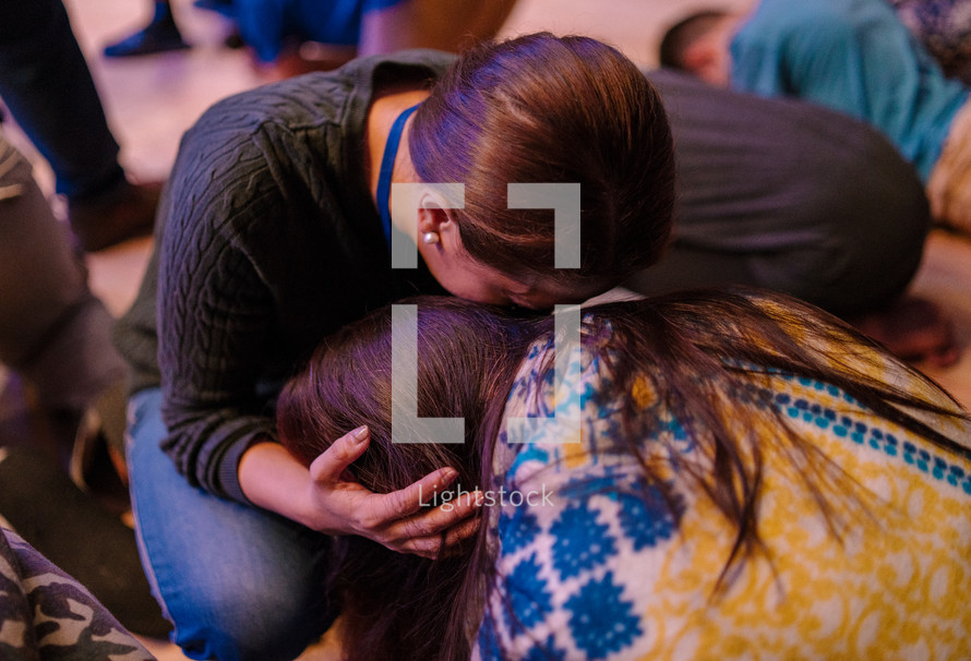 hugs and tears during a worship service