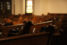 Church pews and stained glass windows, selective focus with shallow depth of field