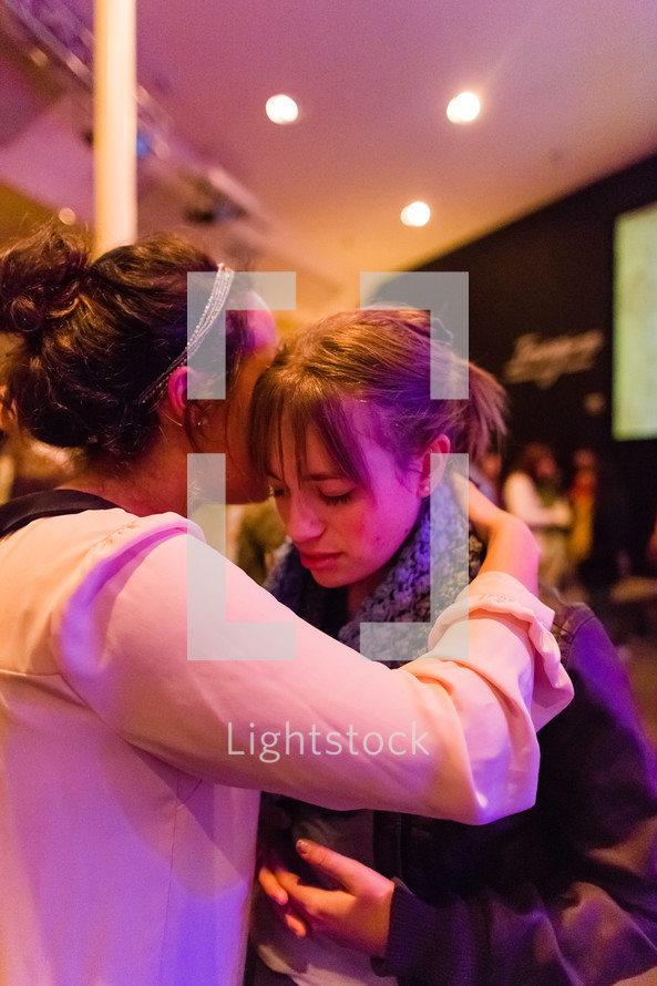 Woman praying for another woman, girl, laying of hands, prayer, faith