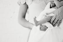 a mother cradling a newborn