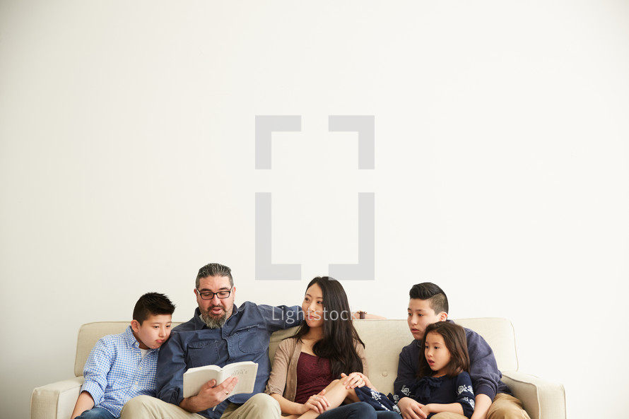 quality family time spent reading a Bible together