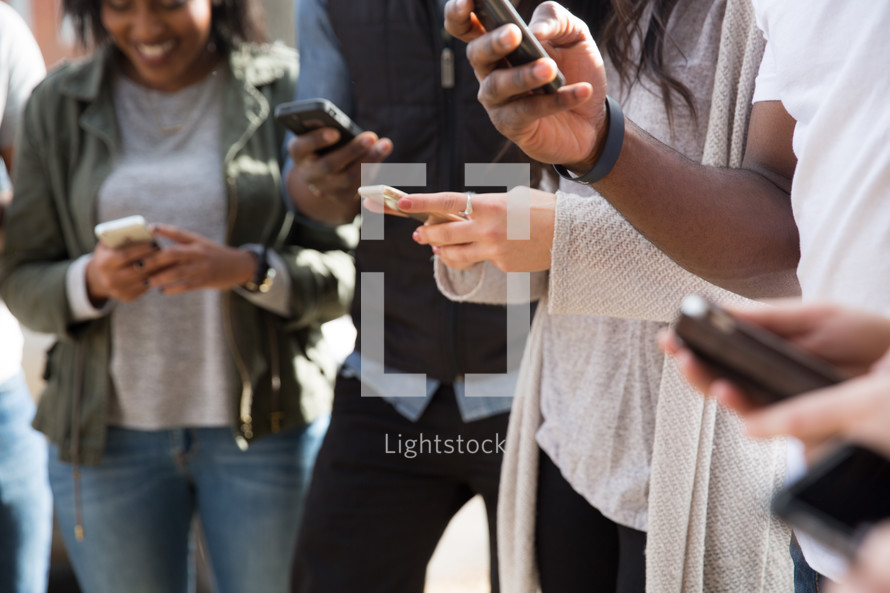 group of friends on their cellphones