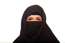 a Muslim woman in a niqab smiling