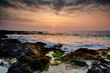 sunrise over a rocky bay
