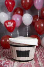 barrel and red balloons