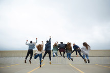 group of teens jumping in celebration
