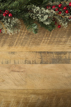 holly Christmas border on wood