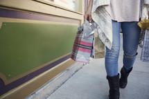 woman carrying Christmas gift bags
