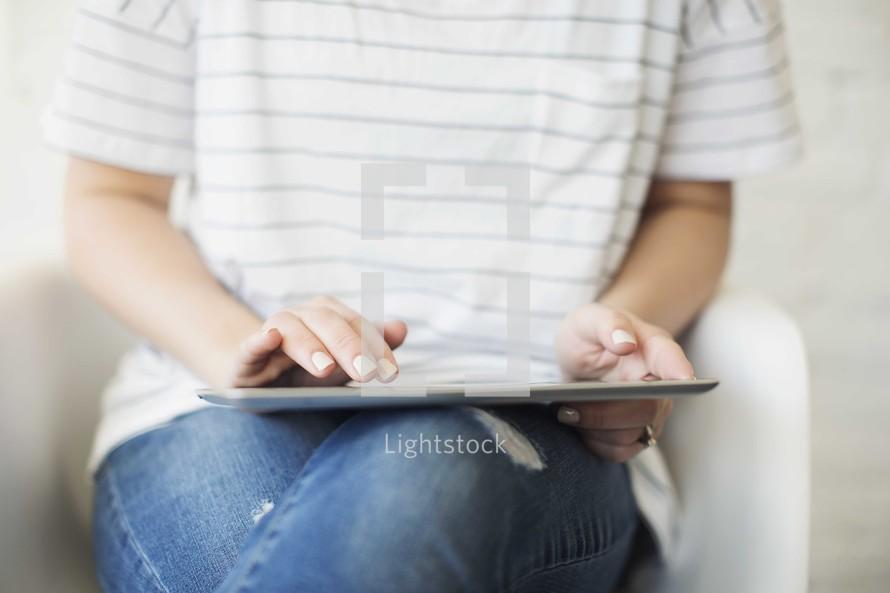 a woman holding an iPad