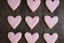 pink icing on heart shaped cookies