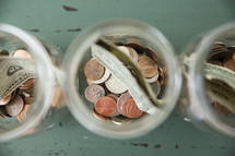 money divided in jars