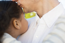 a father kissing his daughter's forehead