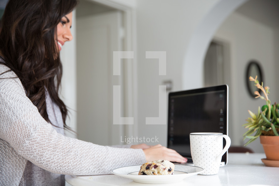 woman typing on a laptop computer