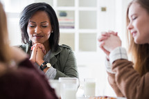 prayer and breakfast at a woman's group gathering