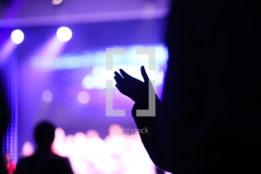 clapping hands at a concert