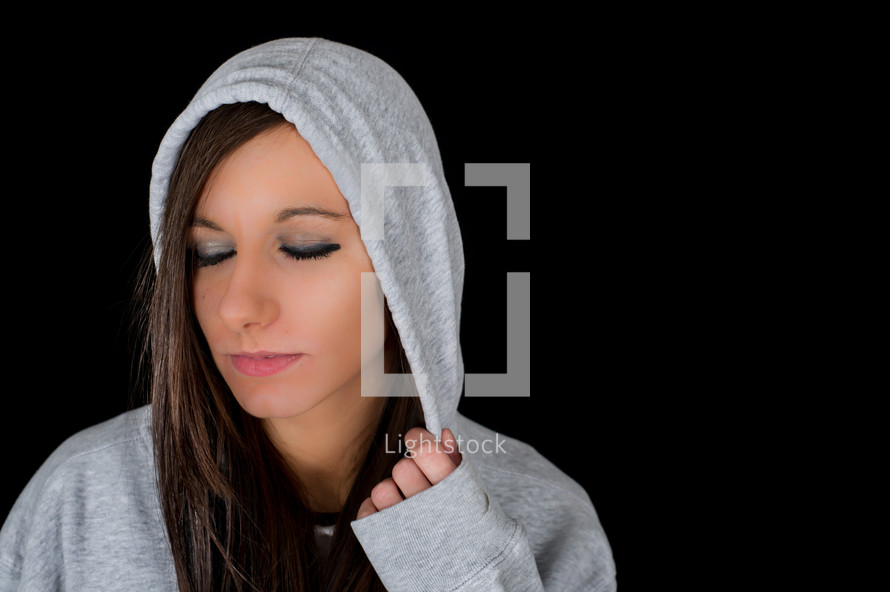 A woman in a hoodie.