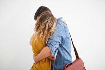 man comforting a woman