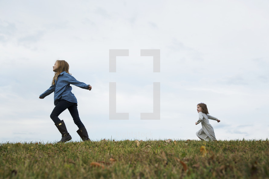 children running in grass outdoors
