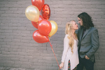 couple and balloons