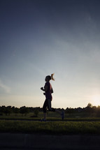 woman jogging at sunset