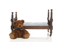 teddy bear and doll bed