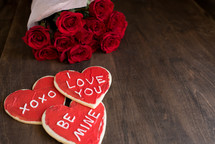 Valentine's cookies and bouquet of red roses