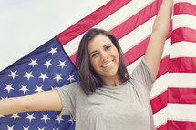 Young woman holding an American Flag