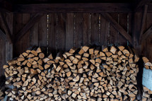 stacked firewood in a shed