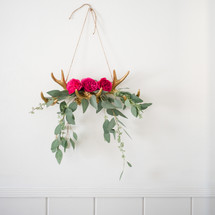 antlers holding flowers and eucalyptus