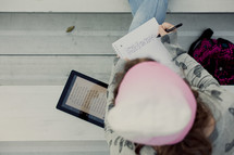 Teenage girl reading bible on an iPad,  1 Timothy 4:12,  bleachers, youth, student technology, study, devotional, writing Jeremiah 29:11