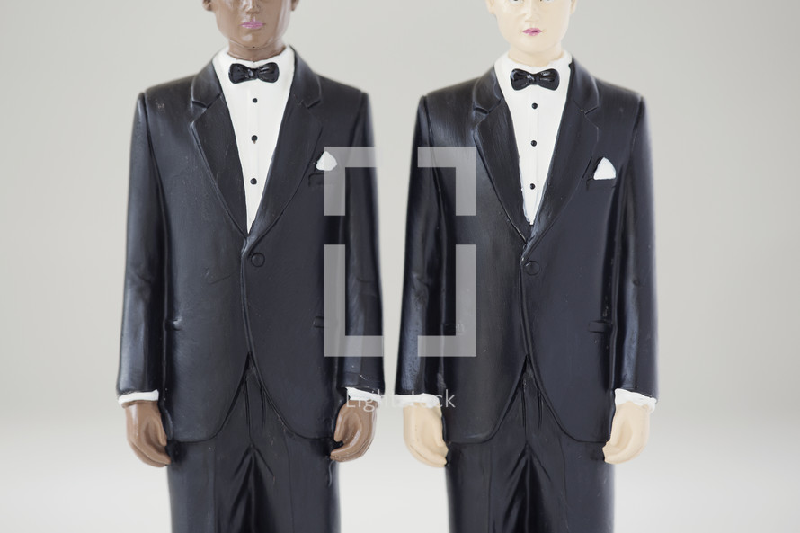 two male cake toppers.